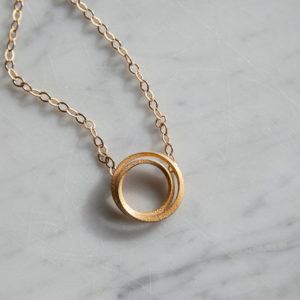 Eclipse gold pendant necklace for women