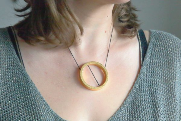 Saturn gold and steel pendant necklace